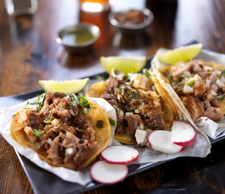 mexican tacos with limes and radish slices