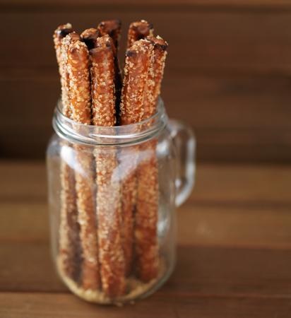 salty: candied pretzel sticks in mason jar with turbinado sugar and sea salt