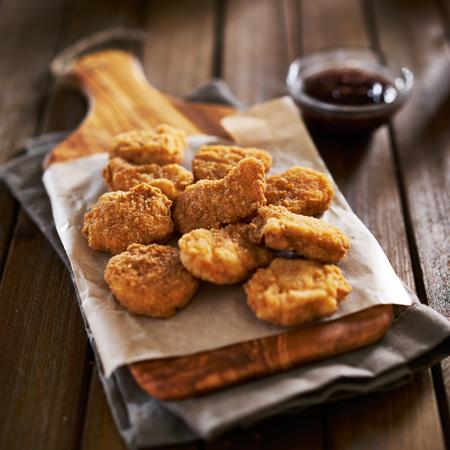 pile of crispy homemade baked chicken nuggets cooling Standard-Bild