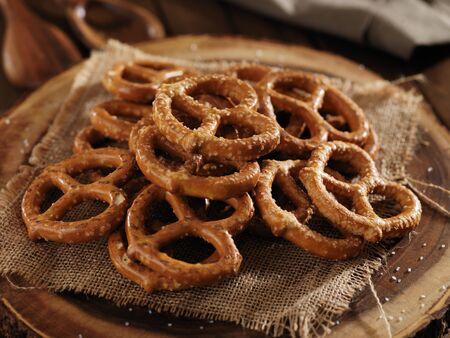 salted pile of crispy pretzels close up