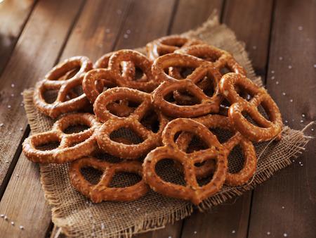 salty: pile of pretzels close up photo