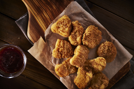 top down: golden crispy homemade chicken nuggets from overhead top down view Stock Photo