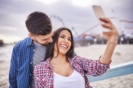 flirty: flirty couple taking selfie near santa monica california Stock Photo