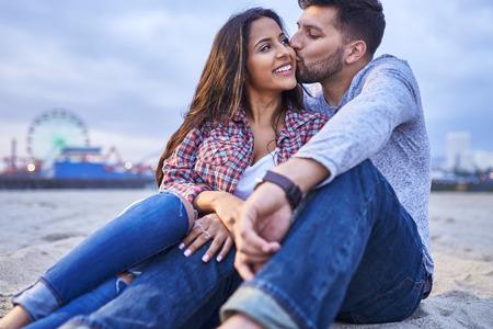 boyfriend giving girlfriend a kiss on the cheek