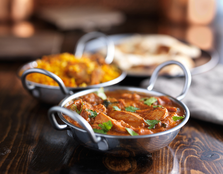 indian butter chicken curry in balti dish