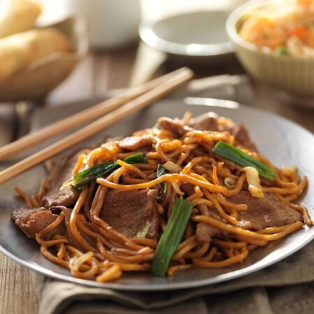 lo mein: plate of chinese beef lo mein with chopsticks