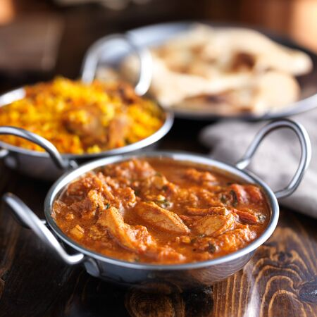 indian curry: balti dish with butter chicken indian curry