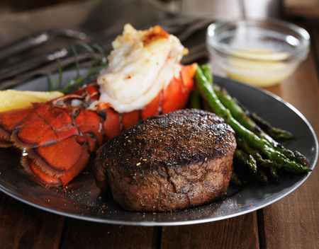 surf and turf meal with filet mignon, lobster tail and asparagus