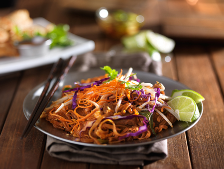 stir fry: beef pad thai stir fry dish on plate with chopsticks