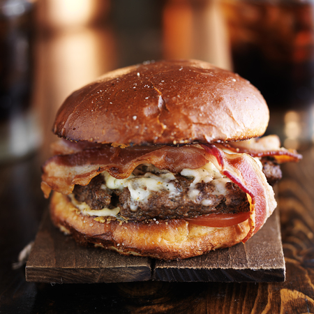 big juicy burger with bacon and melted pepper jack cheese