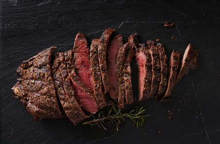 flat iron: grilled flat iron steak shot in flat lay style from overhead
