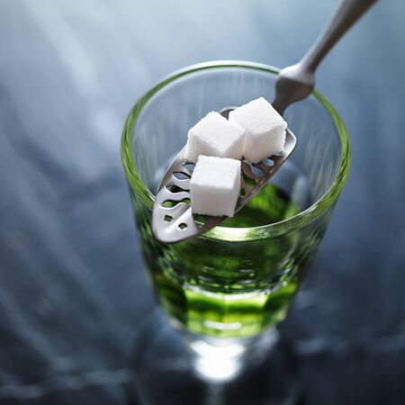 ajenjo: absinthe in pontarlier glass with spoon and sugar cubes