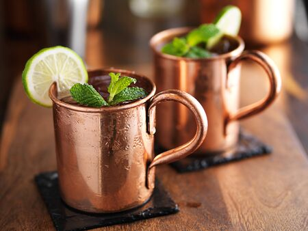 mules: moscow mules in copper cups on slate coasters Stock Photo
