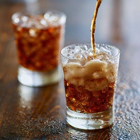 soda pop: pouring cola soda pop into cup