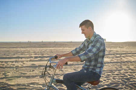 monica: man riding bicyle on santa monica beach