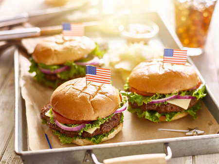 themed: cheese burgers on tray with flags in 4th of july theme