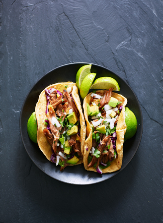 top down phot of two mexican carnitas tacos on place in flat lay composition