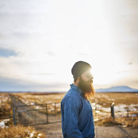 nowhere: bearded man wondering around the middle of nowhere in nevada at sunset
