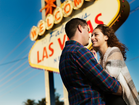 las vegas sign: happy couple together at las vegas sign Stock Photo