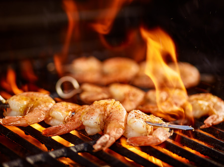 grilling shrimp on skewer on grill