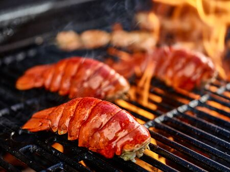 grilling lobster over hot flame