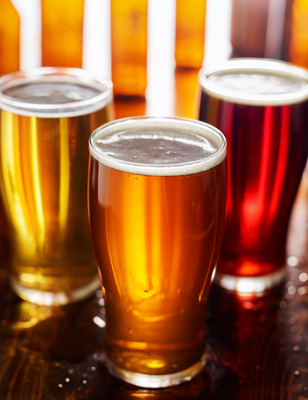 three different types of beer in glass mugs Stock Photo
