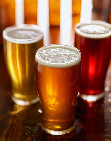 ipa: three different types of beer in glass mugs Stock Photo
