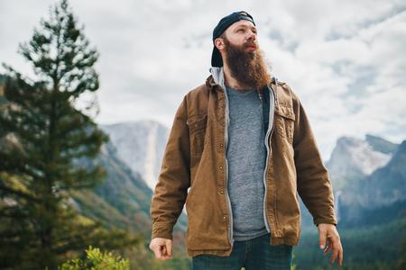 bearded guy in coat at yosemite