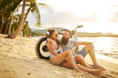 romantic couple couple with motorbike in thailand watching sunset Stock Photo