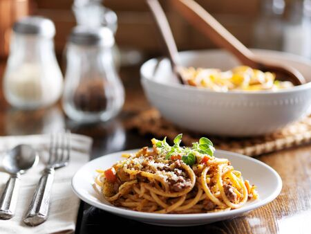 spaghetti dinner with beef, parmesan and oregano