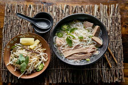 vietnamese pho with beef brisket in flat lay composition Stock Photo