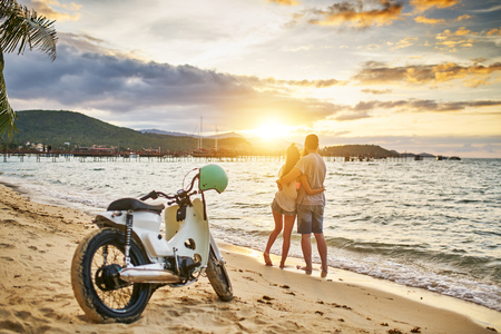 romantic couple watching sunset on koh samui thailand