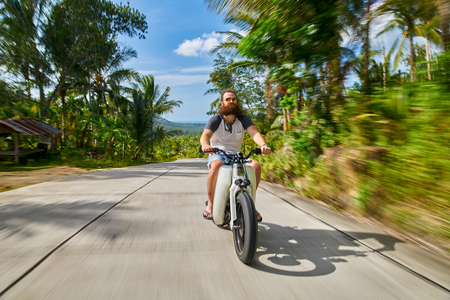 man driving vintage motorbike at high speed in thailand with motion blur photo