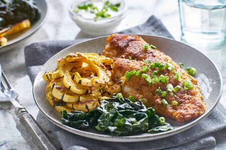 pan fried catfish with spinach and squash