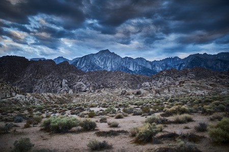 mountains and rock at alabama hills california with moody clouds