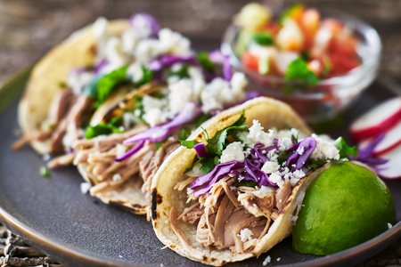 Street tacos - with carnitas, red cabbage and queso fresco cheese