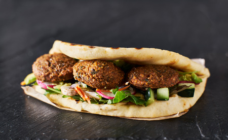 tasty vegan falafel wrap shot with selective focus 스톡 콘텐츠