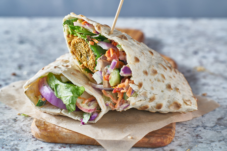 vegan food- tasty falafel wrap in gluten free bread Stok Fotoğraf - 95815283