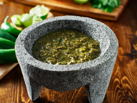 mexican salsa verde in traditional stone molcajete