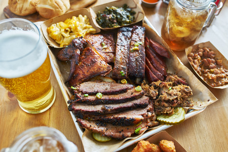 texas style bbq tray with smoked brisket, st louis ribs, pulled pork, chicken, hot links, and sides Stock fotó - 118468791