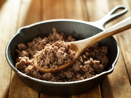 spoonful of freshly cooked ground beef from iron skillet