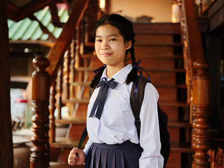 Portrait of thai teen in school uniform with backpack ready for school Stockfoto