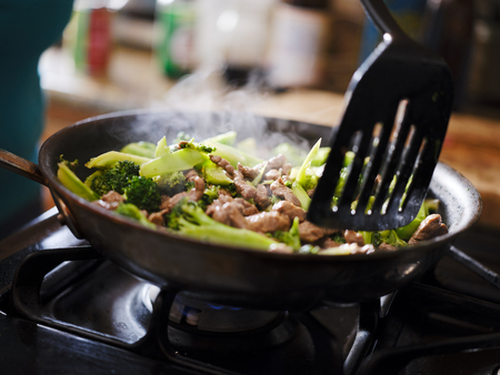 cooking beef and broccoli stir-fry in hot pain inside home kitchen Reklamní fotografie
