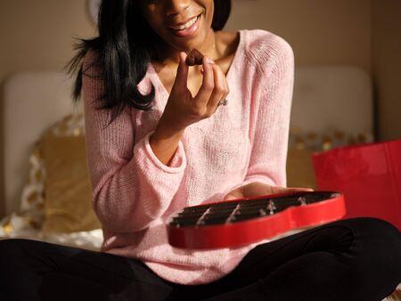 Close up of woman holding romantic valentines chocolate Standard-Bild