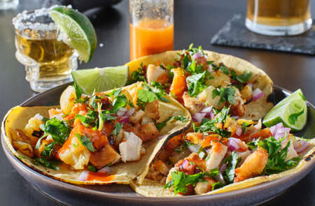 chicken and grilled pineapple street tacos with hot sauce