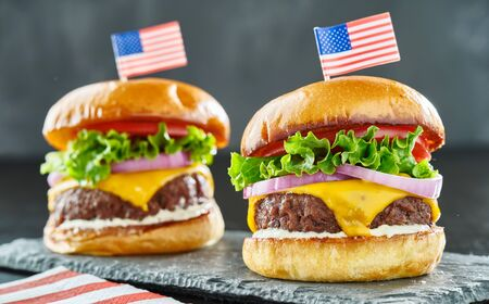 4th of july themed cheeseburgers with mini flags
