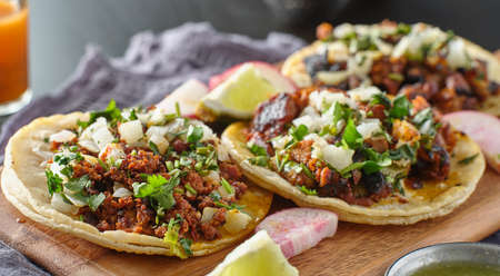 mexican street tacos with carne asada on corn tortillas platter