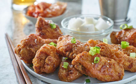 korean fried chicken wings with pickled radish and kimchi