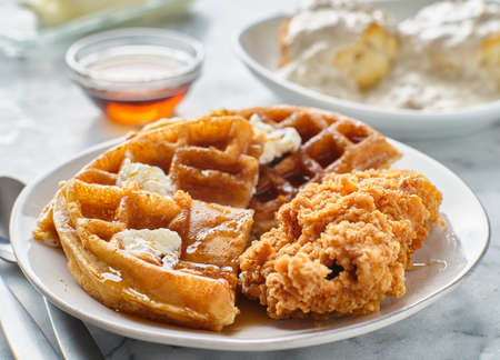 fried chicken and waffles breakfast with syrup Imagens