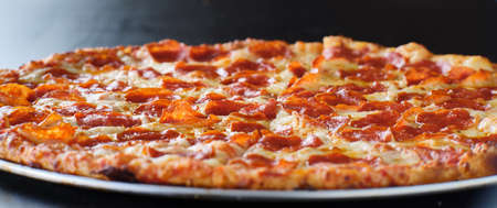 large american style pepperoni and cheese pizza